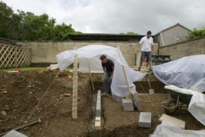 wall-foundations-in-landscaped-garden-with-plastic-sheeting-covering-new-brick-walls-130792690-57d4b23b3df78c58334ba360